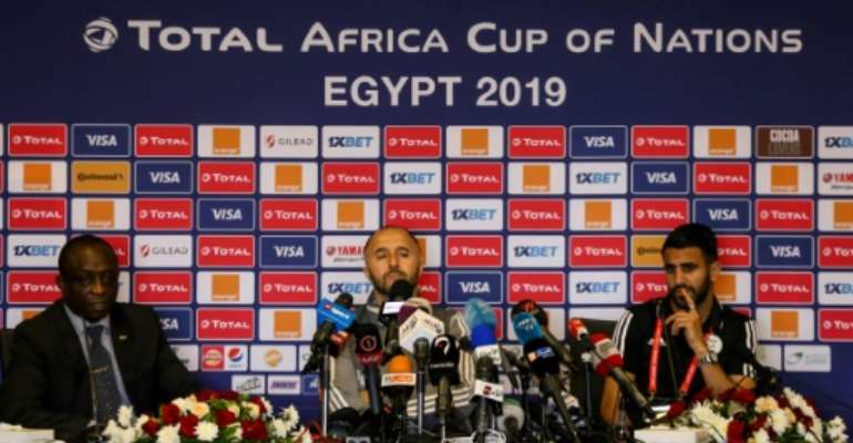 Algeria's coach Djamel Belmadi (C) warned not to take
