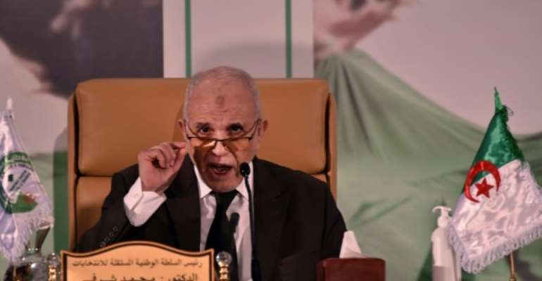 Algeria's electoral authority chief Mohamed Charfi announcing the result of the referendum on Monday.  By RYAD KRAMDI (AFP)