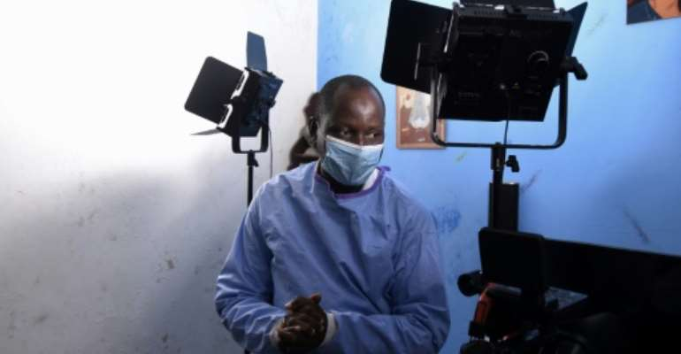 Alioune Thiam, who plays Dr. Diouf in a Senegalese TV show, 'The Virus'.  By Seyllou (AFP)