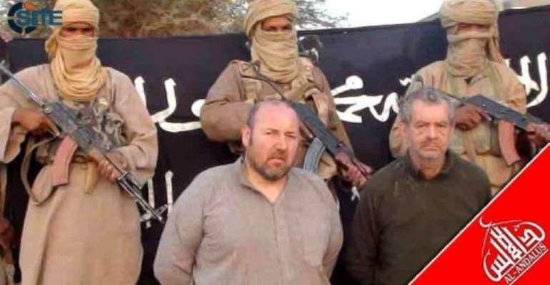 A SITE Monitoring Service photo shows two Westerners kidnapped by Al-Qaeda.  By  (AFP/SITE Monitoring Service)