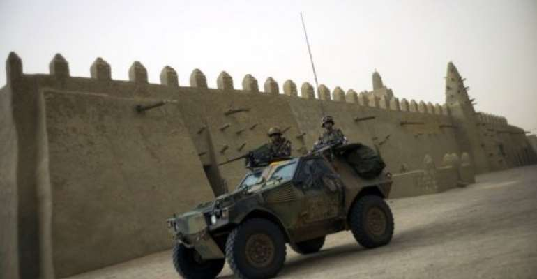 French soldiers patrol in an armoured vehicle next to the Djingareyber mosque, on January 31, 2013 in Timbuktu.  By Fred Dufour (AFP/File)