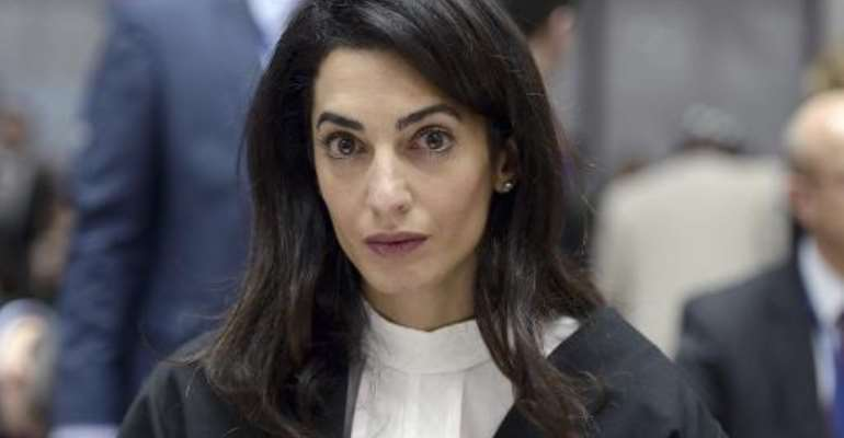 Lawyer Amal Clooney waits on January 28, 2015 for the start of a hearing before the European Court of Human Rights in the eastern French city of the Strasbourg.  By Frederick Florin (AFP/File)