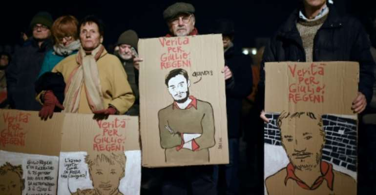 Amnesty International activists in Turin mark the fourth anniversary of the death of Italian student Giulio Regeni, whose mutilated body was found on the outskirts of Cairo days after he disappeared on January 25, 2016.  By Marco BERTORELLO (AFP/File)
