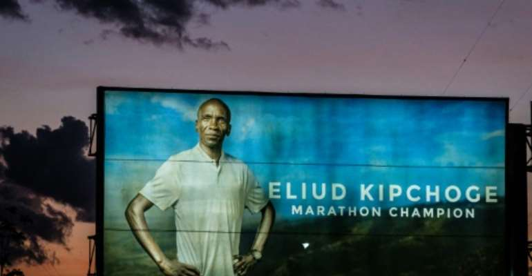 An advertising billboard in Kenya shows Olympic marathon champion and World record holder Eliud Kipchoge who will attempt to break the two-hour marathon barrier on Saturday.  By Yasuyoshi CHIBA (AFP)