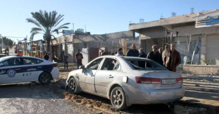 An air strike in Zawiya near the Libyan capital Tripoli hit a pharmacy, a bakery and cars parked on the street, the mayor of the town said.  By - (AFP)