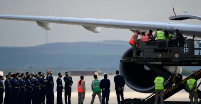 An Airbus 310 jet belonging to the Spanish air force took off with the bodies of the journalists and conservation campaigner.  By JAVIER SORIANO (AFP)