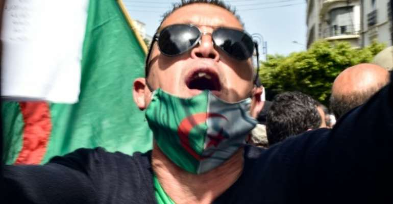 An Algerian man take part in a protest in the capital Algiers demanding an independent judiciary.  By RYAD KRAMDI (AFP)