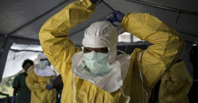 An Ebola worker in DR Congo dons full protective gear against the lethal virus.  By John WESSELS (AFP)