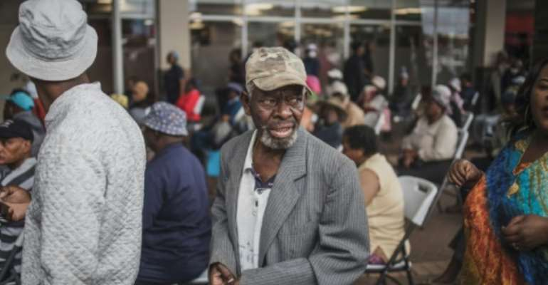 An elderly man from Soweto queues to collect his social grant.  By MARCO LONGARI (AFP)