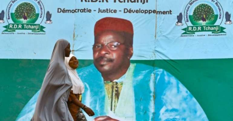 An election campaign poster for opposition leader Mahamane Ousmane in Niamey. Ousmane says he won Sunday's runoff, although official results say he lost by more than 11 percentage points.  By Issouf SANOGO (AFP)