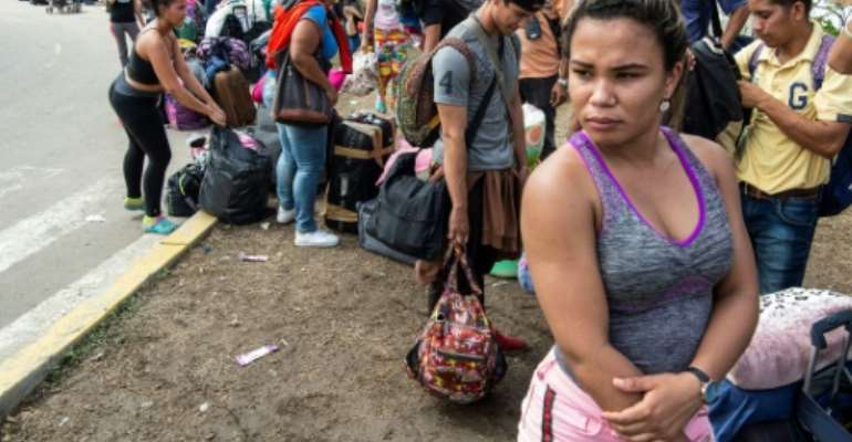 An estimated 3.3 million people have left Venezuela since the start of 2016, according to the UN..  By Cris BOURONCLE (AFP/File)