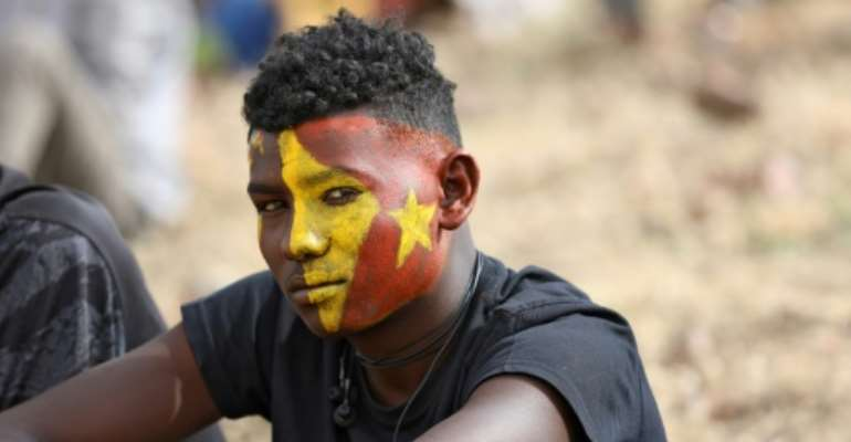 An Ethiopian refugee in Sudan's Um Raquba camp attends a gathering to celebrate the anniversary of the Tigray People's Liberation Front.  By Hussein Ery (AFP)