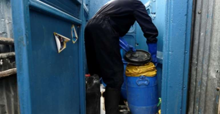 An expanding fleet of eco-friendly lavatories in the Nairobi slum of Mukuru is helping cut down on people throwing their waste out of the window in a bag.  By SIMON MAINA (AFP)