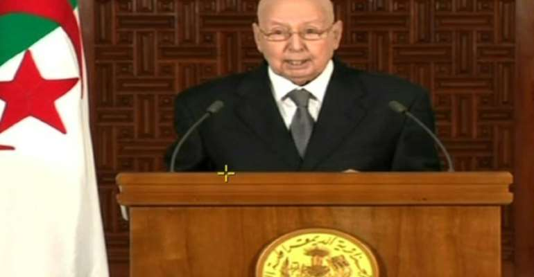 An image grab from the Algerian national television chanel on July 3, 2019, shows Algerian interim President Abdelkader Bensalah addressing the nation.  By  (Algerian TV/AFP)