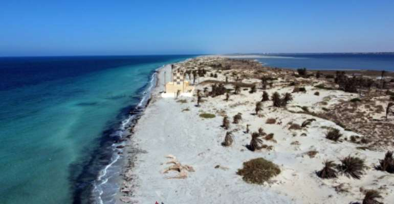 An uninhabited 13-kilometre-long (eight mile) sandbar cut off at high tide in far western Libya, Farwa appears picture-postcard idyllic, with scattered date palms on white sandy beaches and ringed by the sparkling Mediterranean Sea.  By Mahmud TURKIA (AFP)
