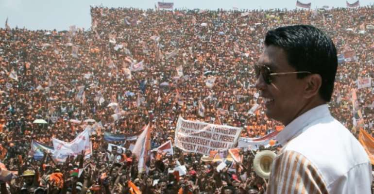 Andry Rajoelina, pictured here at a campaign rally, is ahead in Madagascar's vote count. He is on course for a runoff on December 19 against another former president, Marc Ravalomanana.  By RIJASOLO (AFP)