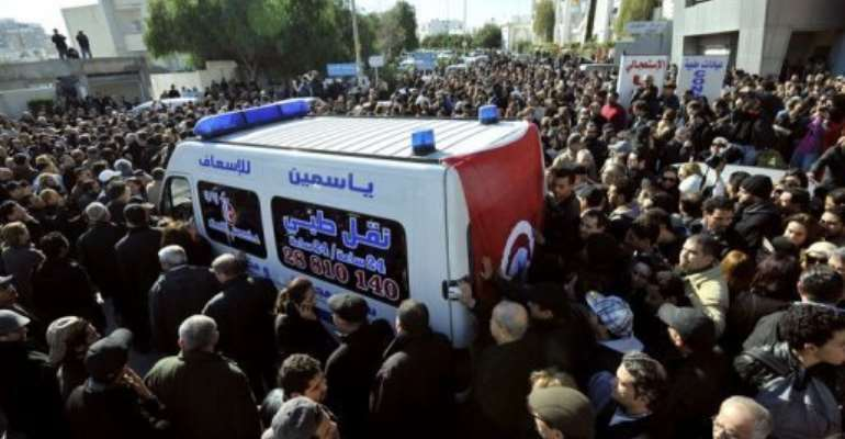 An ambulance takes the body of Chokri Belaid to hospital in Tunis after he was shot dead on February 6, 2013.  By Fethi Belaid (AFP)