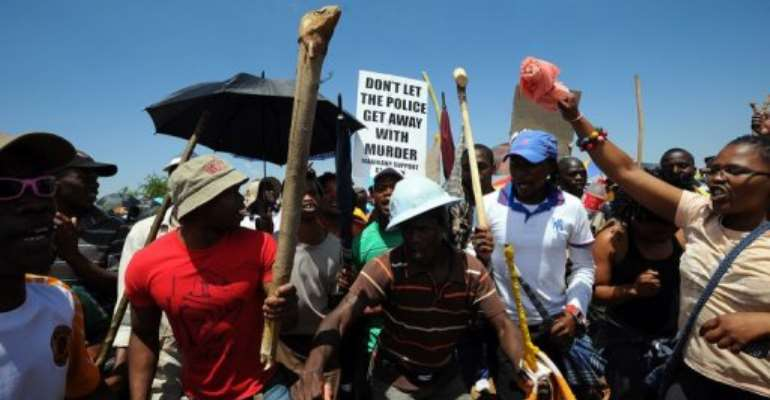 Striking miners stage a protest at the AngloGold Ashanti mine in Carletonville on October 19, 2012.  By Alexander Joe (AFP/File)