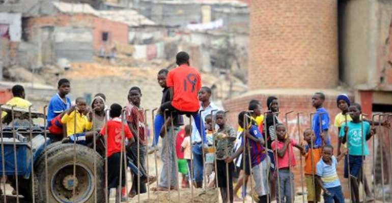 Some kids stand at the Boa Vista slum, in the outskirts of Luanda, on August 31, 2012.  By Stephane de Sakutin (AFP/File)