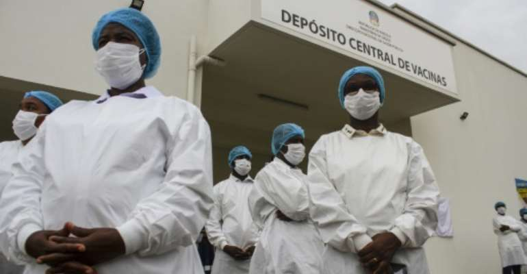 Angolan health workers were vaccinated almost immediately after the doses were unloaded.  By Osvaldo Silva (AFP)