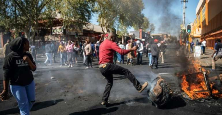 Angry protesters looted alleged foreign-owned shops in Johannesburg in a new wave of violence.  By Michele Spatari (AFP)