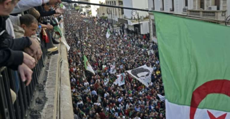 Anti-regime protesters marched through central Algiers on December 6, protesting against the upcoming presidential election.  By RYAD KRAMDI (AFP/File)