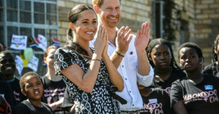 Applause: Prince Harry and Meghan visited a Cape Town rights group fighting gender violence. Rape and murder of women have reached epidemic proportions in South Africa.  By Courtney AFRICA (POOL/AFP)