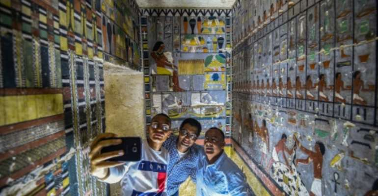 Archaelogists inside the newly discovered tomb of Khuwy, who is believed to have been a nobleman during the Fifth Dynasty, which ruled over Egypt about 4300 years ago.  By Mohamed el-Shahed (AFP)