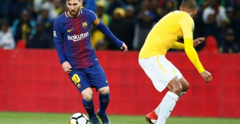 Argentine superstar Lionel Messi (L) playing for Barcelona last year at Soccer City, the Soweto stadium with a 90,000 capacity.  By PHILL MAGAKOE (AFP)