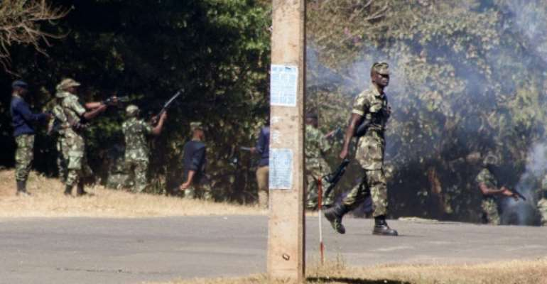 Armed Malawian policemen fired teargas to disperse supporters of The Malawi Congress Party (MCP) in Lilongwe.  By AMOS GUMULIRA (AFP)