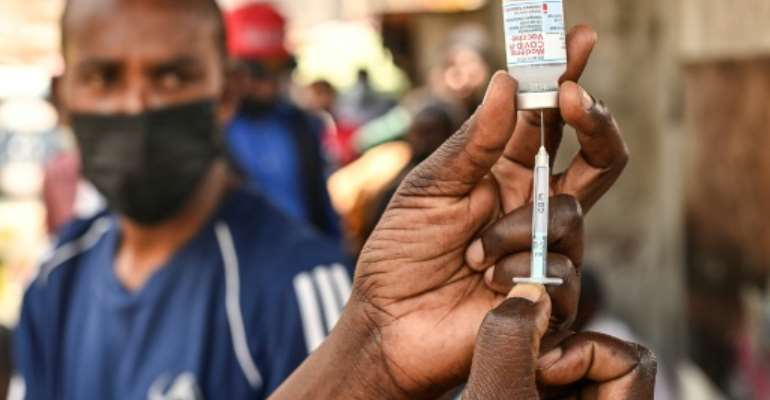 Around 57 million vaccine doses have been donated to Africa by other countries and private firms.  By Simon MAINA (AFP/File)