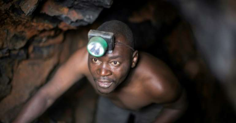 Artisanal miners in the vast central African country often work in difficult conditions, ignoring safety norms.  By GRIFF TAPPER (AFP/File)