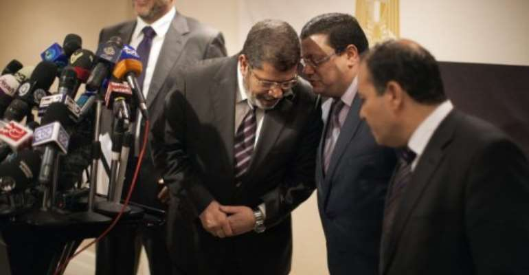 Mursi appealed to Egyptians to pursue the goals of the revolution.  By Marco Longari (AFP)