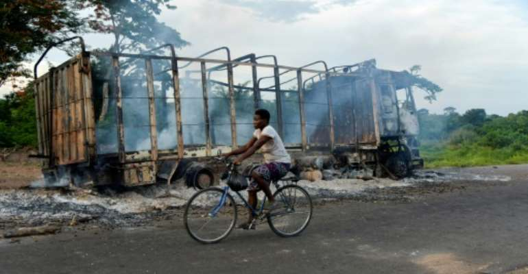 As well as the killings, houses, cars and other property were burned during the violence.  By Sia KAMBOU (AFP)