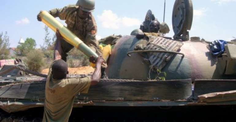 African Union soldiers load a tank shell in Somalia.  By Mohamed Abdiwahab (AFP/File)