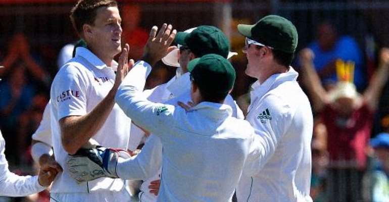 South Africa cricketer Morne Morkel (left) celebrates with teammates after he cleaned bowled Australia's Nathan Lyon, during their second Test in Port Elizabeth on February 22, 2014.  By Alexander Joe (AFP)