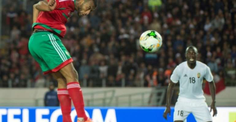 Ayoub el Kaabi (L) scores one of his nine goals that helped power hosts Morocco to the 2018 African Nations Championship title.  By Fadel SENNA (AFP)