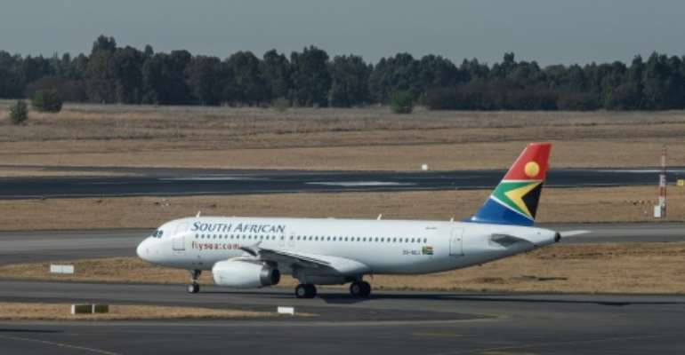 Back in business: The SAA flight readies for takeoff at Johannesburg's O.R. Tambo airport.  By Emmanuel Croset (AFP)