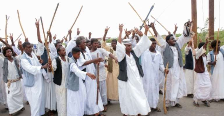 Backers of a chief of the Beja minority protesting in eastern Sudan wave in support as he meets with a delegation led by a member of Sudan's Sovereign Council in the city of Port Sudan.  By Ibrahim ISHAQ (AFP)