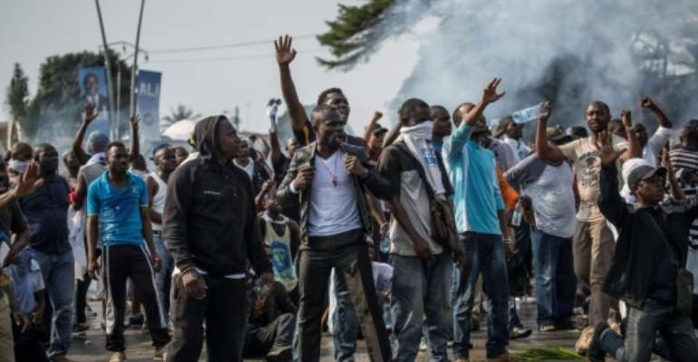 Backers of Gabonese opposition presidential candidate Jean Ping take to the streets on August 31, 2016, protesting his announced defeat by incumbent Ali Bongo.  By MARCO LONGARI (AFP/File)