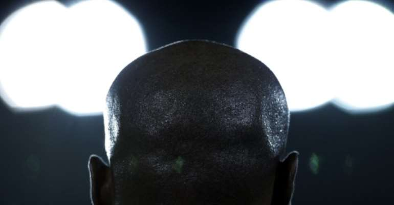 Bald individuals are rich, according to Mozambique superstition and culture.  By MAURICIO LIMA (AFP)