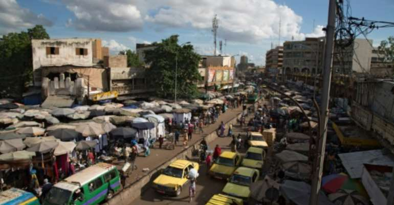 Bamako, Mali's capital, continues its daily life with its usual difficulties a week after a coup ousted the country's president.  By ANNIE RISEMBERG (AFP)