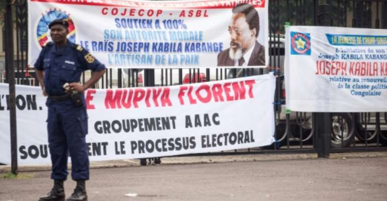 Banners are seen in support of President of the Democratic Republic of Congo, Joseph Kabila, who has promised to step down but still wields influence over who his successor might be.  By Junior D. KANNAH (AFP/File)