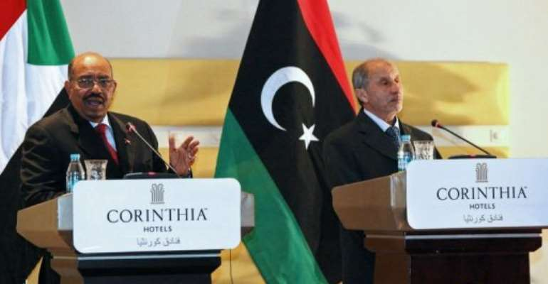 Bashir's arrival in Tripoli marked his first Libya visit since Kadhafi was ousted.  By Mahmud Turkia (AFP)