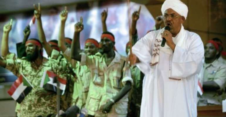 Sudanese President Omar al-Bashir speaks at the National Congress Party headquarters.  By Ashraf Shazly (AFP)