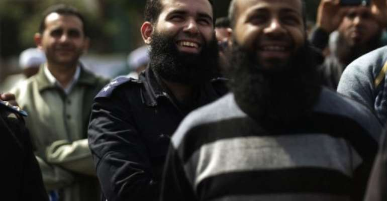 A bearded Egyptian police officer takes part in a protest in Cairo on March 1, 2013.  By Gianluigi Guercia (AFP)