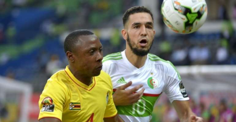 Before his accident, Zvirekwi (L) played for the national squad during the 2017 Africa Cup of Nations.  By KHALED DESOUKI (AFP)