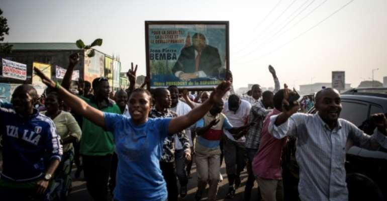 Bemba's supporters celebrate in Kinshasa on June 8 after he was acquitted on appeal.  By JOHN WESSELS (AFP/File)