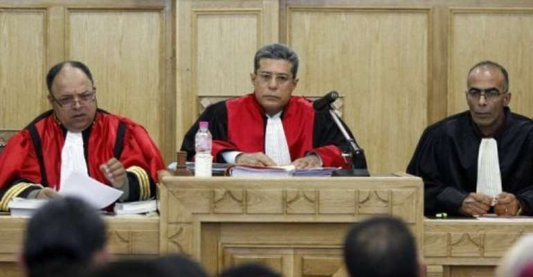 Tunisian military judge Hedi Ayari (C) addresses a military court.  By Salah Habibi (AFP/File)