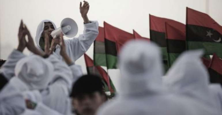 Libyan youth celebrate in the eastern city of Benghazi.  By Gianluigi Guercia (AFP)